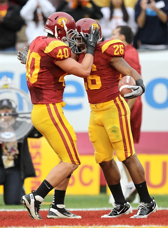 LOS ANGELES, CA - NOVEMBER 12:   Running backs Marc Tyler #26 and Rhett Ellison #40 of the USC Trojans  celebrate Tyler's one yard touchdown run in the second quarter against the Washington Huskies at the Los Angeles Memorial Coliseum on November 12, 2011 in Los Angeles, California.  (Photo by Stephen Dunn/Getty Images)