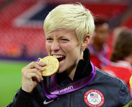 FILE PHOTO: Megan Rapinoe of the U.S. celebrates after defeating Japan in the women's final soccer match at the London 2012 Olympic Games in London at Wembley Stadium, August 9, 2012. REUTERS/Nigel Roddis