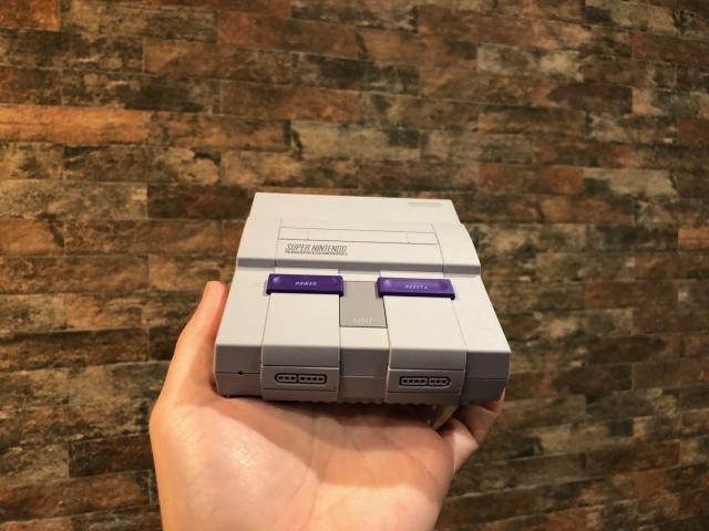 The SNES Classic will literally fit in the palm of your hand.