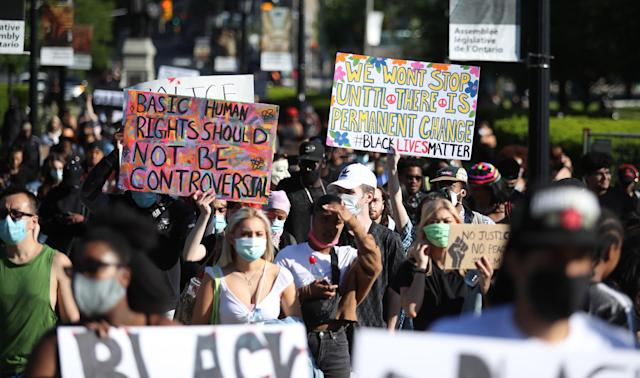 Protesters in downtown Toronto on Saturday. (Steve Russell/Toronto Star via Getty Images)