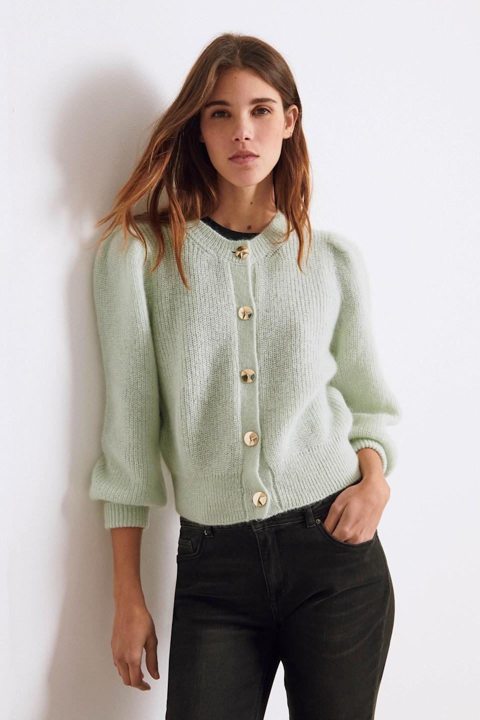 """More in the pistachio world: This wool- and mohair-blend cardigan could totally pass for a cropped jacket, thanks to the round neckline and puff sleeves that add instant structure. $295, Ba&sh. <a href=""""https://ba-sh.com/us/p/cardigan-baylor-vertdeau-3664784378815.html"""" rel=""""nofollow noopener"""" target=""""_blank"""" data-ylk=""""slk:Get it now!"""" class=""""link rapid-noclick-resp"""">Get it now!</a>"""