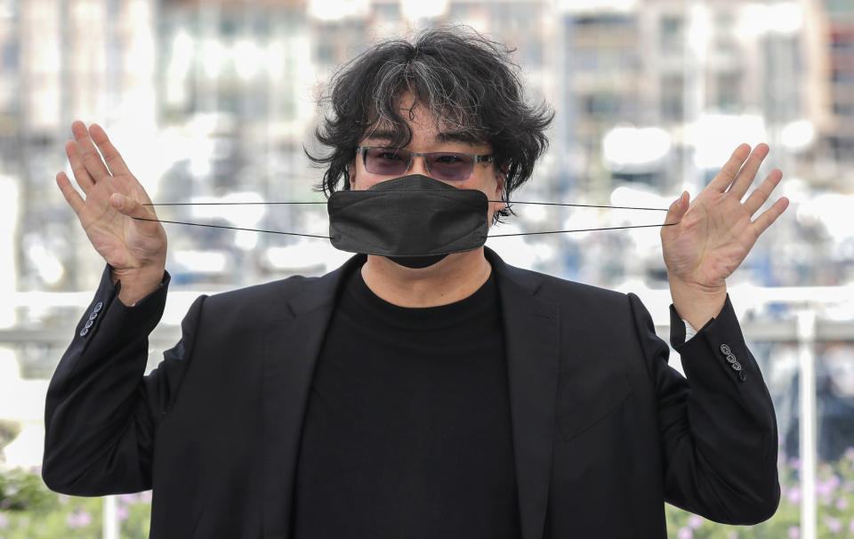 FILE - In this July 7, 2021 file photo Director Bong Joon Ho poses for photographers at a photo call during the 74th international film festival, Cannes, southern France. (Photo by Vianney Le Caer/Invision/AP, File)