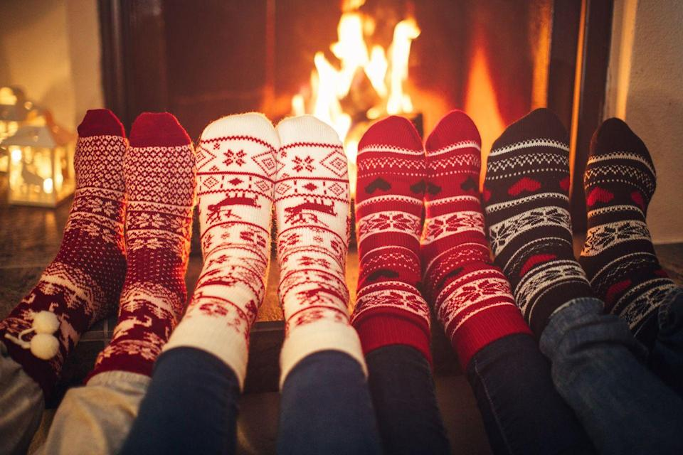 """<p>Before you start unwrapping gifts, build a roaring fire in the fireplace. It will get everyone into the Christmas spirit faster than you can say """"time to open the stockings."""" Speaking of, make sure you take those down first, or you'll end up with melted candy.</p>"""