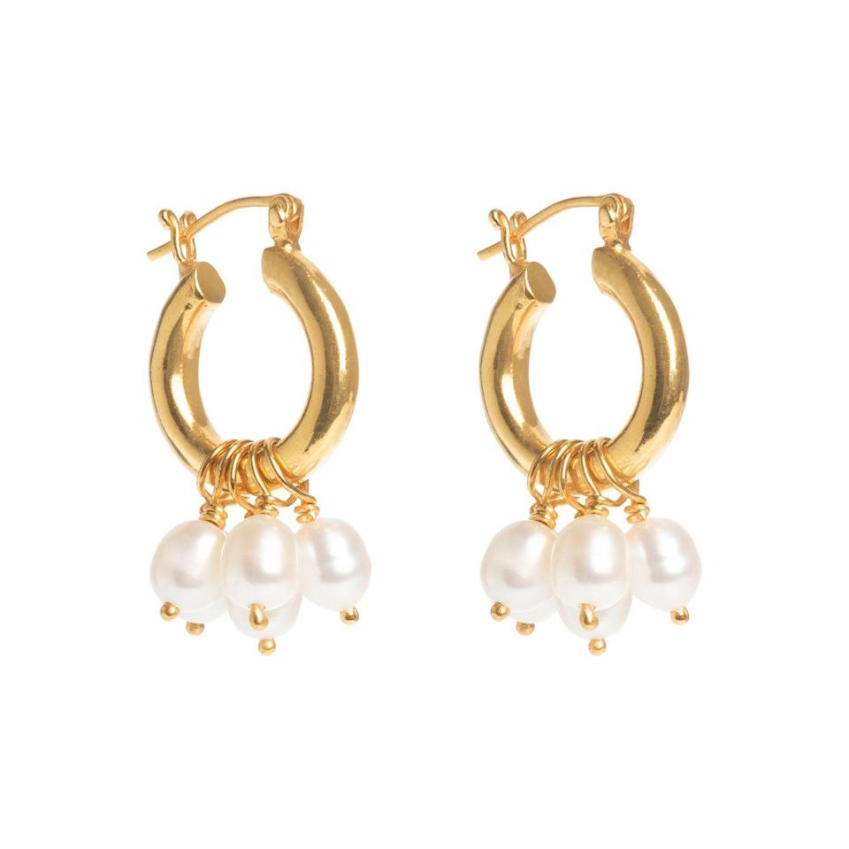 """<p><a class=""""link rapid-noclick-resp"""" href=""""https://freyarose.com/collections/jewellery/products/baroque-mini-hoops-with-pearl-drops"""" rel=""""nofollow noopener"""" target=""""_blank"""" data-ylk=""""slk:SHOP NOW"""">SHOP NOW</a></p><p> Freya Rose's playful hoop earrings, as worn by <a href=""""https://www.harpersbazaar.com/uk/celebrities/news/a36427119/prince-william-kate-middleton-wolverhampton-mental-health-awareness-week/"""" rel=""""nofollow noopener"""" target=""""_blank"""" data-ylk=""""slk:the Duchess of Cambridge"""" class=""""link rapid-noclick-resp"""">the Duchess of Cambridge</a>, are the perfect everyday accessory. Detachable pearl drops enable you to dial the drama up or down as you need, to suit every mood and outfit. </p><p>Gold plate and freshwater pearl earrings, £95, Freya Rose</p>"""