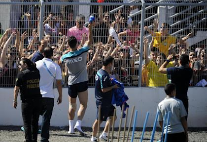 Cristiano Ronaldo throws a shirt to fans after a training session. (AP)