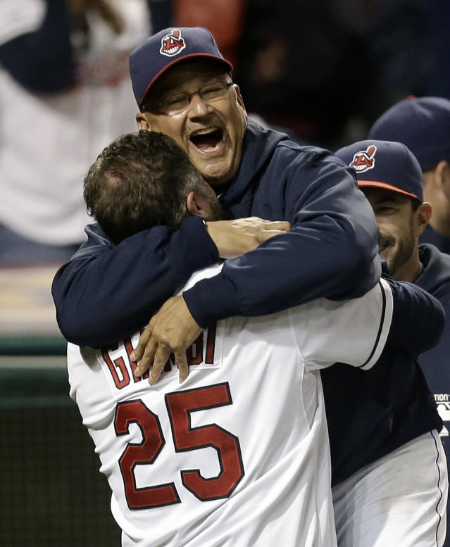 FILE - In this Sept. 24, 2013, file photo, Cleveland Indians designated hitter Jason Giambi, left, picks up manager Terry Francona after Giambi hit a two-run home run off Chicago White Sox relief pitcher Addison Reed in the ninth inning of a baseball game in Cleveland. Francona was selected as the AL Manager of the Year on Tuesday, Nov. 12, 2013, by the Baseball Writers' Association of America. (AP Photo/Tony Dejak, File)