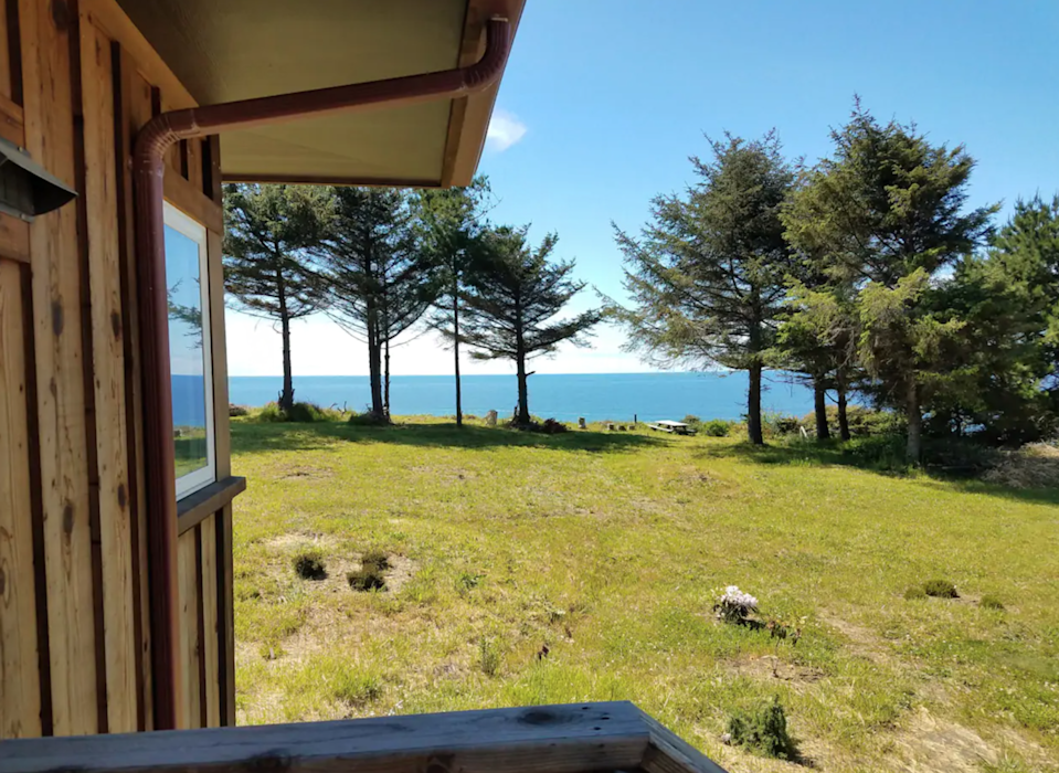 """<h2>Redwood National Park, California</h2><br><strong>Location: </strong>Trinidad, California<br><strong>Sleeps: </strong>4<br><strong>Price Per Night: </strong><a href=""""https://airbnb.pvxt.net/BX5Qn0"""" rel=""""nofollow noopener"""" target=""""_blank"""" data-ylk=""""slk:$184"""" class=""""link rapid-noclick-resp"""">$184</a><br><br>""""Our cliff house has its west side (almost all windows) facing the Pacific Ocean, natural wood siding, cabin look, quiet neighborhood, dead end road, newly built in 2016. The famous Agate beach is right below our cliff. There are two ways to get there (including driving) 2/3 of a mile to Big Lagoon Park, then both lagoon and beach are right there.""""<br><br><h3><a href=""""https://airbnb.pvxt.net/BX5Qn0"""" rel=""""nofollow noopener"""" target=""""_blank"""" data-ylk=""""slk:Book Trinidad Home With Ocean View"""" class=""""link rapid-noclick-resp"""">Book Trinidad Home With Ocean View</a></h3><span class=""""copyright"""">Photo: Courtesy of Airbnb.</span>"""