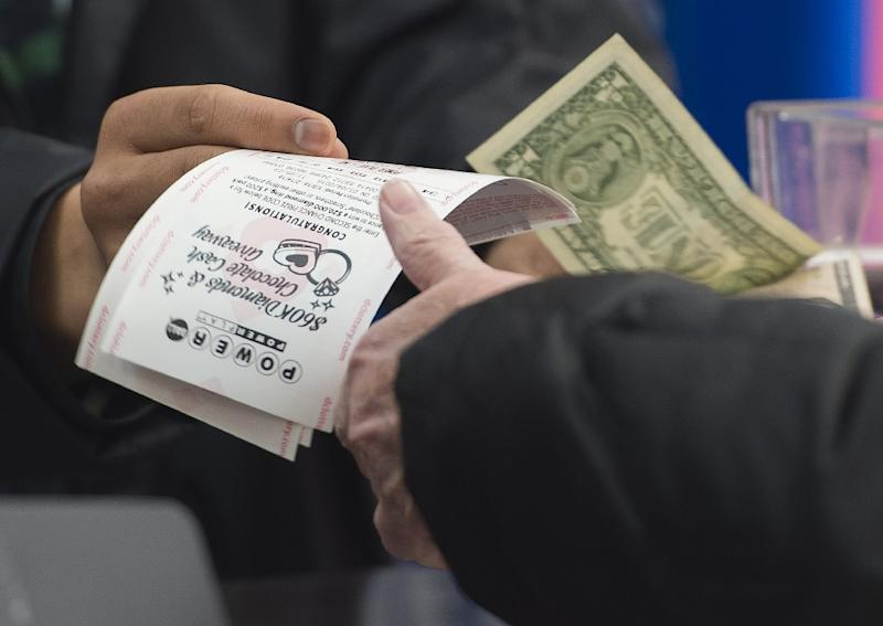 The winner of the Powerball can choose to be paid the full jackpot in annual installments over 29 years -- or take a lower one-off payment in cash