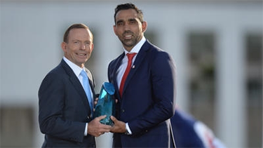 Prime Minister Tony Abbott with Australian of the Year Adam Goodes. Photo: AAP