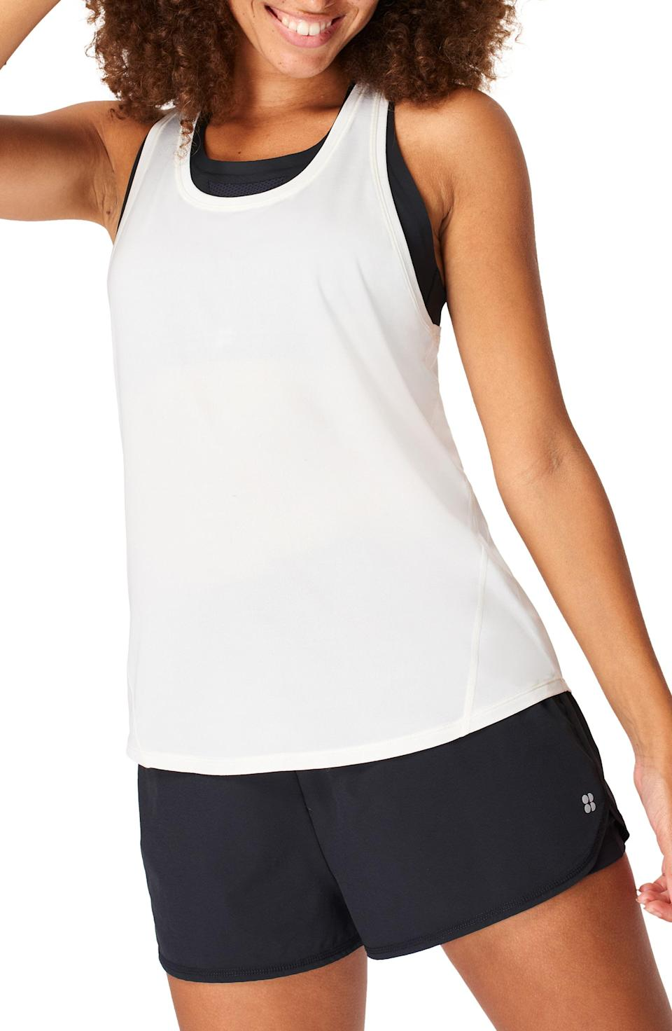 """<p><strong>Sweaty Betty</strong></p><p>nordstrom.com</p><p><strong>$32.40</strong></p><p><a href=""""https://go.redirectingat.com?id=74968X1596630&url=https%3A%2F%2Fwww.nordstrom.com%2Fs%2Fsweaty-betty-energize-racerback-workout-tank%2F6433726&sref=https%3A%2F%2Fwww.prevention.com%2Ffitness%2Fworkout-clothes-gear%2Fg37542513%2Fworkout-tops-for-women%2F"""" rel=""""nofollow noopener"""" target=""""_blank"""" data-ylk=""""slk:Shop Now"""" class=""""link rapid-noclick-resp"""">Shop Now</a></p><p>""""It fits true to size, feels soft, and dries quickly after a tough workout,"""" wrote one Nordstrom shopper. So you can stay cool and confident as you move through your next class with this breezy racerback. It <strong>has a lightweight fabric that wicks away sweat</strong> and has a comfortable fit that allows you to move around freely.</p>"""