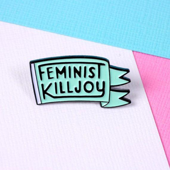 """Get it <a href=""""https://www.etsy.com/listing/274472086/feminist-killjoy-enamel-pin-with-clutch?ga_order=most_relevant&ga_search_type=all&ga_view_type=gallery&ga_search_query=feminism&ref=sr_gallery_13"""" target=""""_blank"""">here</a>."""