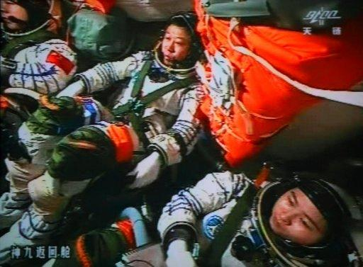 Chinese astronauts Liu Wang (centre), Jing Haipeng (left) and Liu Yang in the Shenzhou-9 spacecraft