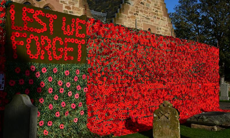 Thousands of hand-crocheted and knitted poppies in remembrance of the fallen adorn Aberlady parish church in Musselburgh, Scotland