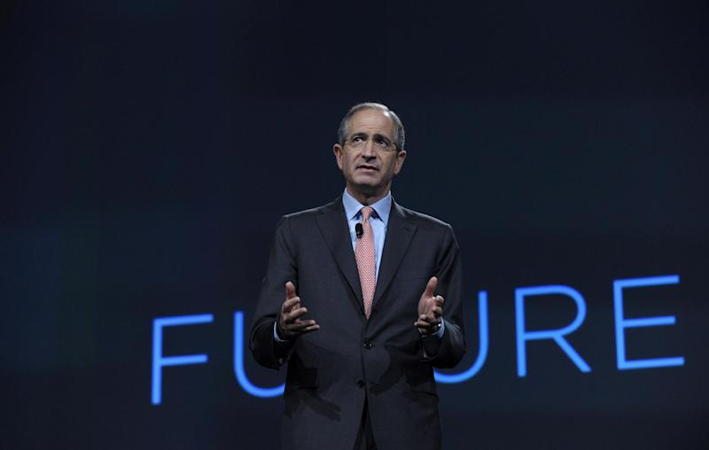 Comcast Corp. CEO Brian Roberts gestures as he speaks during The Cable Show 2013 convention in Washington, Tuesday, June 11, 2013. The nation's largest cable TV provider, Comcast Corp., unveiled a new, compact set-top box that does away with the hard drive and saves your TV shows online. (AP Photo/Susan Walsh)