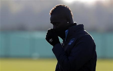 Manchester City's Balotelli arrives for a training session at the club's Carrington training complex in Manchester