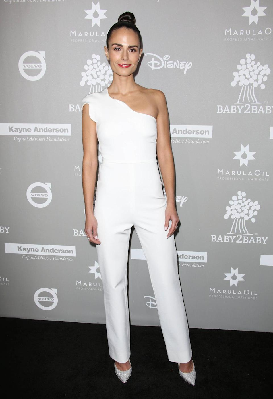 We're a little obsessed with mum-of-one Jordana Brewster's slick top knot and white-as-white-can-be jumpsuit. [Photo: Rex]