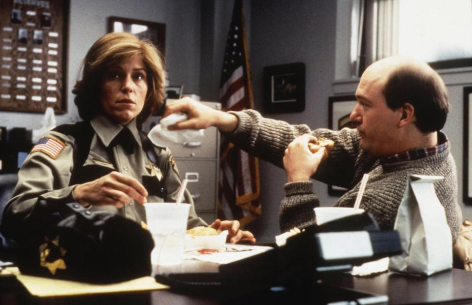 Frances McDormand sits at her police desk with John Caroll Lynch