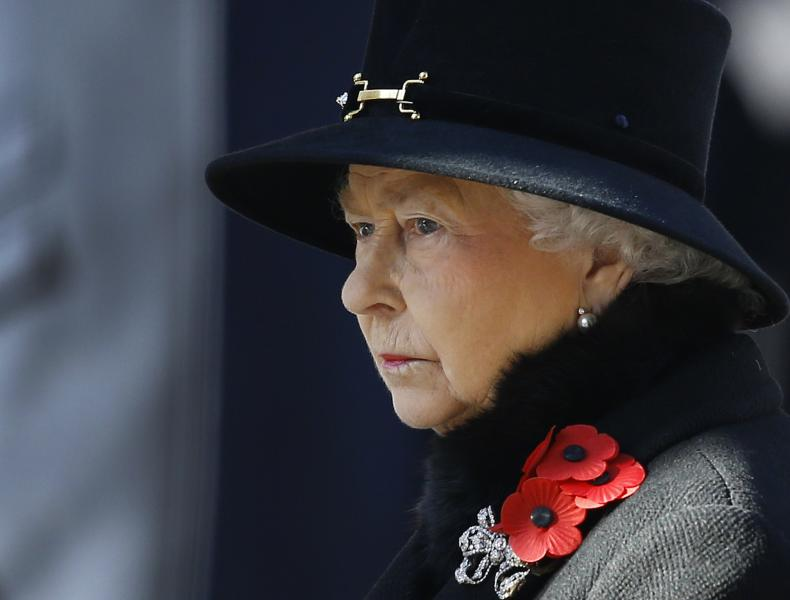 Britain's Queen Elizabeth II listens during the service of remembrance at the Cenotaph in Whitehall, London, Sunday, Nov. 10, 2013. The annual remembrance service is to remember those who have lost their lives serving in the Armed Forces. (AP Photo/Kirsty Wigglesworth)