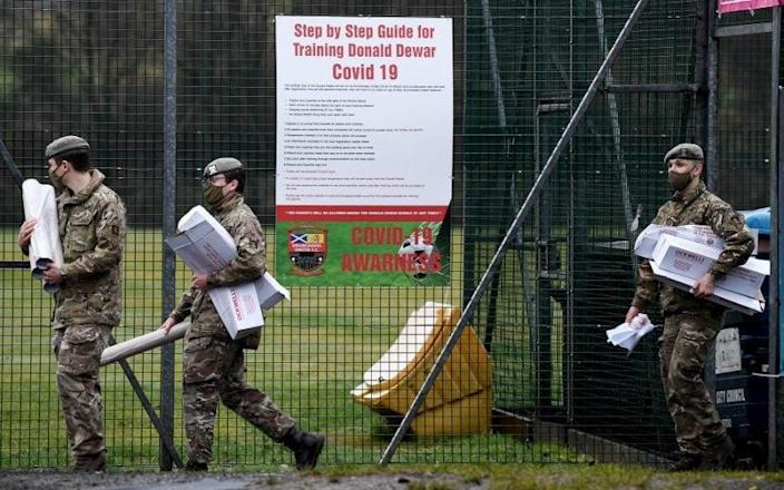 Members of the Royal Scots Dragoon Guard set up a Covid vaccination centre in Glasgow - Jeff J Mitchell/Getty