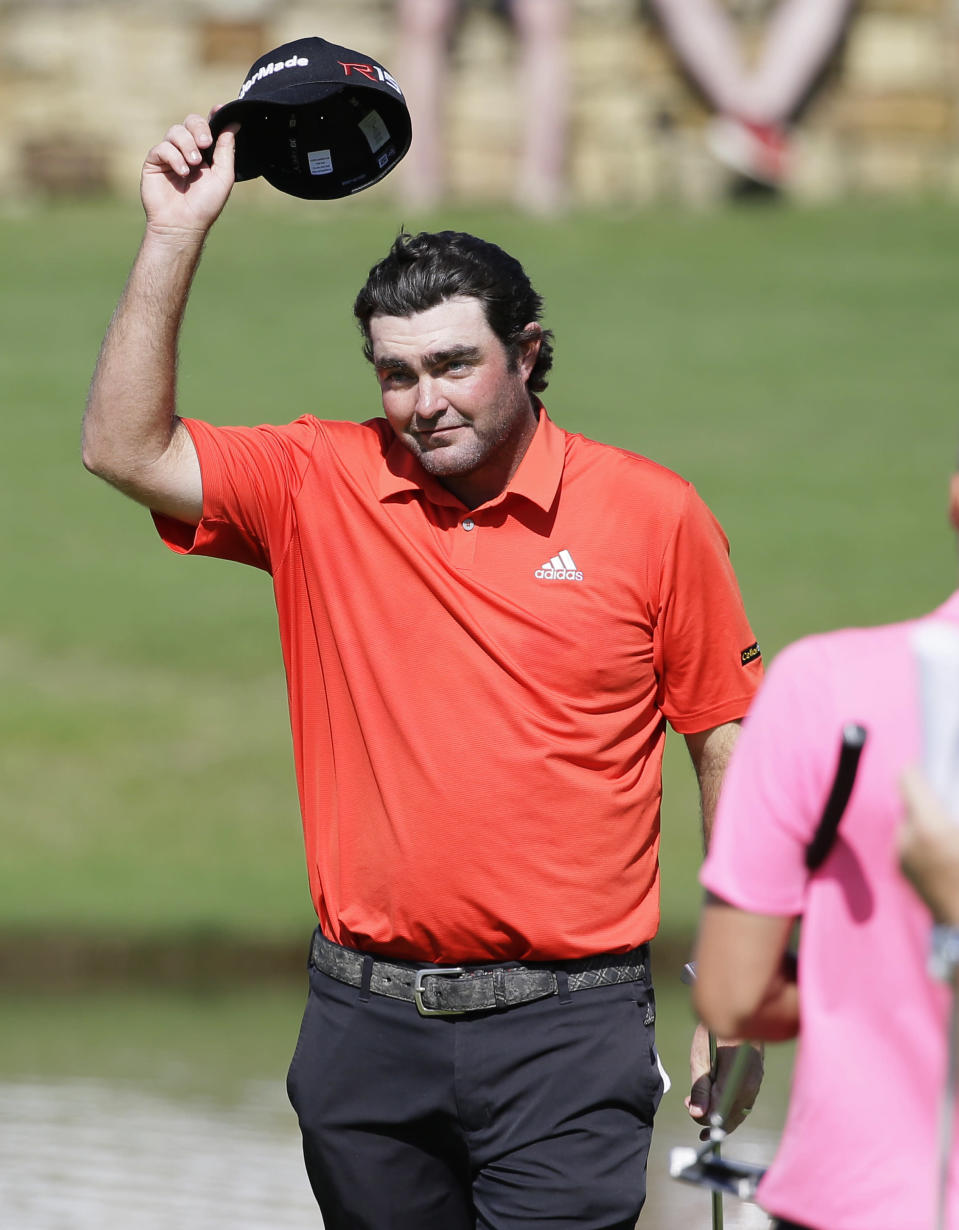 Steven Bowditch takes off his cap after finishing the final round of the Byron Nelson golf tournament, Sunday, May 31, 2015, in Irving, Texas. Bowditch won the tournament. (AP Photo/LM Otero)