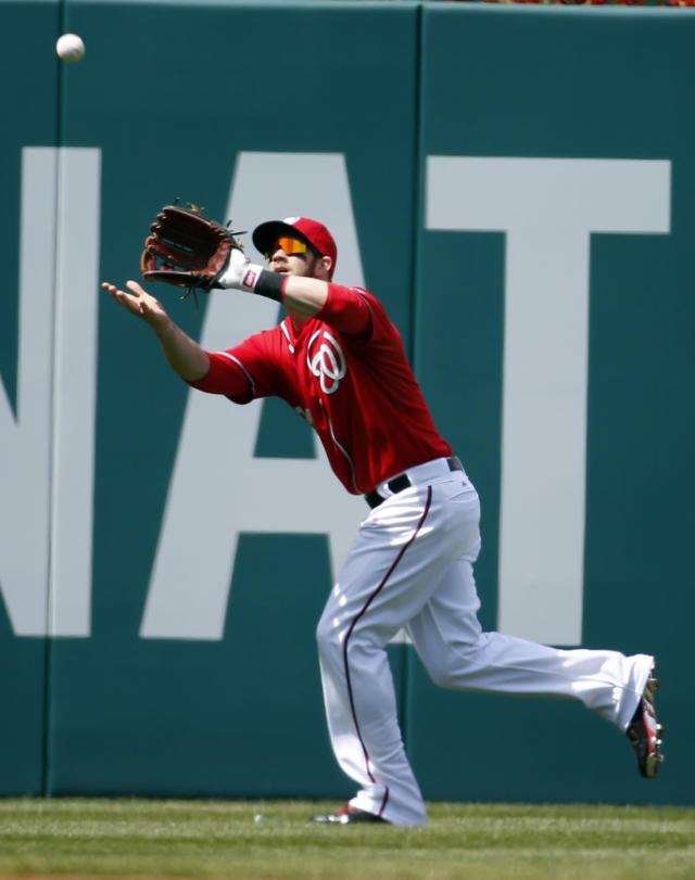 Washington Nationals left fielder Bryce Harper catches a fly ball hit by St. Louis Cardinals' Matt Carpenter during the third inning of a baseball game, Sunday, April 20, 2014, in Washington. (AP Photo/Alex Brandon)