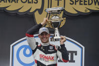 Rinus VeeKay, of the Netherlands, holds the trophy after winning the IndyCar auto race at Indianapolis Motor Speedway, Saturday, May 15, 2021, in Indianapolis. (AP Photo/Darron Cummings)
