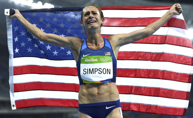 <p>Jenny Simpson of USA celebrates after winning bronze in the women's 1500m final at the Olympic Stadium on August 16, 2016. (REUTERS/David Gray) </p>