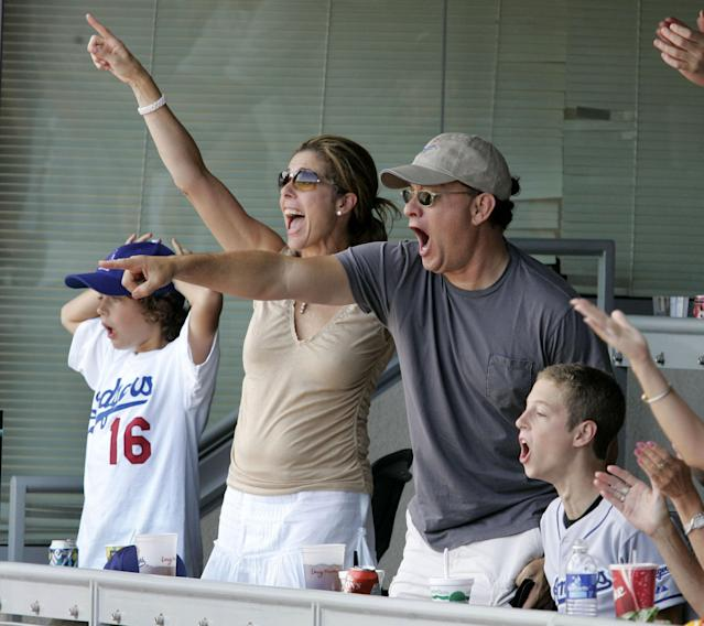 Wilson, Hanks, and their sons at a Dodgers game in 2004. (Photo: Chris Polk/FilmMagic)