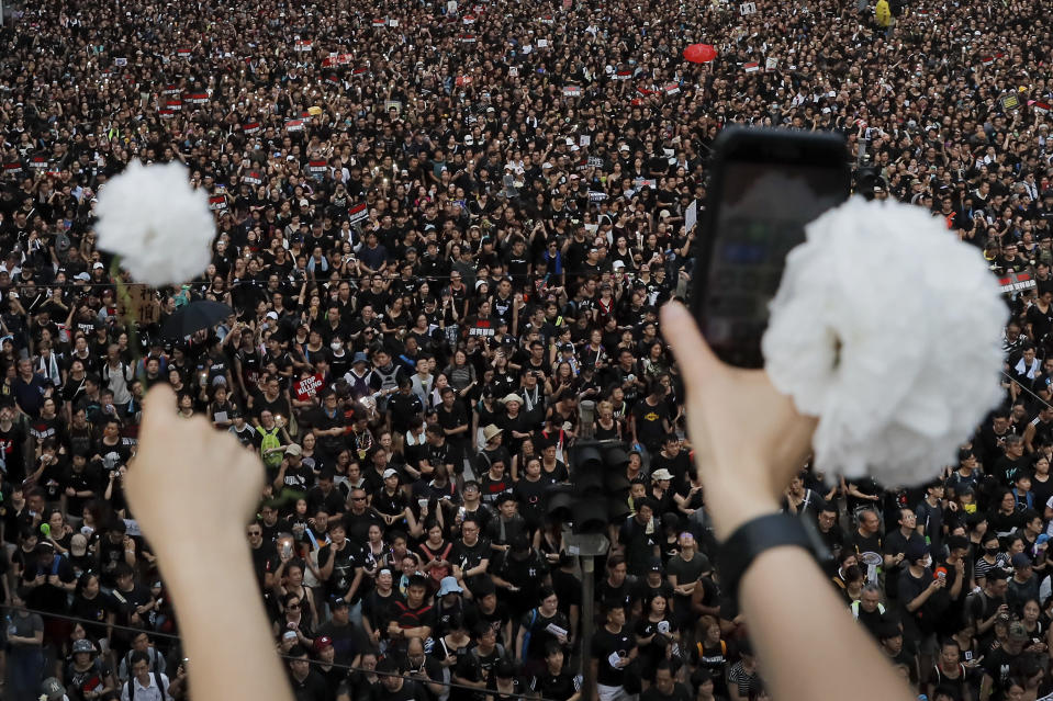 Protesters continue to protest an extradition bill, Sunday, June 16, 2019, in Hong Kong. Hong Kong residents were gathering Sunday for another mass protest over an unpopular extradition bill that has highlighted the territory's apprehension about relations with mainland China. (AP Photo/Kin Cheung)