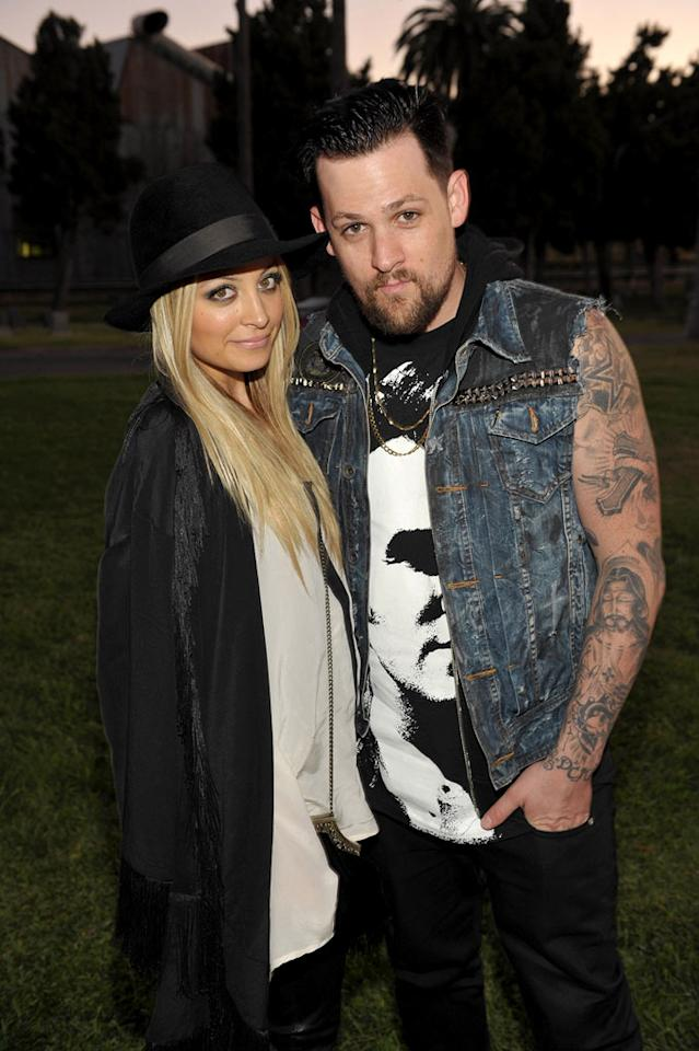 """Nicole Richie is """"threatening to leave"""" Joel Madden if he doesn't quit his band Good Charlotte, reveals the <i>National Enquirer</i>. The mag says Richie is """"fed up"""" with Madden's rocker lifestyle, and tired of him being """"an absentee parent."""" When Madden told Richie he was returning to the recording studio, she """"flipped"""" and made him to choose between his career and kids. For how Madden surprisingly reacted, and whether they're going to split, click over to <a href="""" http://www.gossipcop.com/nicole-richie-leaving-joel-madden-problems-marriage-trouble-good-charlotte-separating/"""" target=""""new"""">Gossip Cop</a>. John Shearer/<a href=""""http://www.wireimage.com"""" target=""""new"""">WireImage.com</a> - August 24, 2011"""