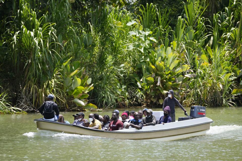 Migrants arrive on a boat to Acandi, Colombia, Tuesday, Sept. 14, 2021. The migrants, following a well-beaten, multi-nation journey towards the U.S., will continue their journey through the jungle known as the Darien Gap. (AP Photo/Fernando Vergara)