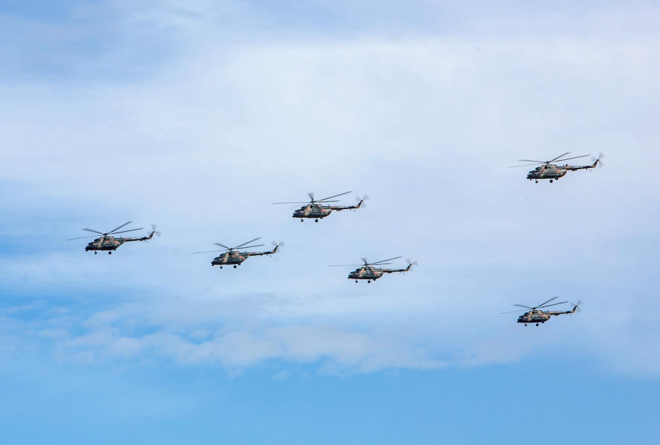 """<em>Russian military helicopters fly during the V<span class=""""s1"""">ostok (East) 2018 manoeuvres (</span>AP)</em>"""