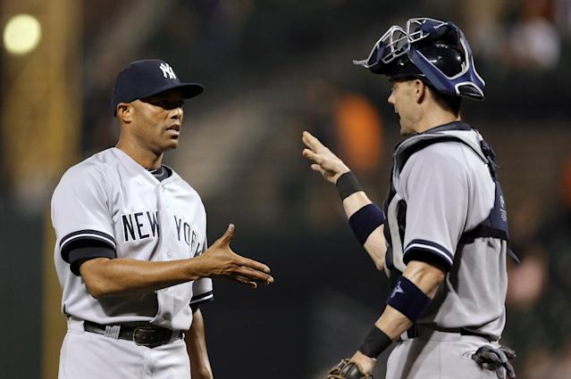 New York Yankees relief pitcher Mariano Rivera, left, shakes hands with catcher Chris Stewart after a baseball game against the Baltimore Orioles, Thursday, Sept. 12, 2013, in Baltimore. New York won 6-5. (AP Photo/Patrick Semansky)