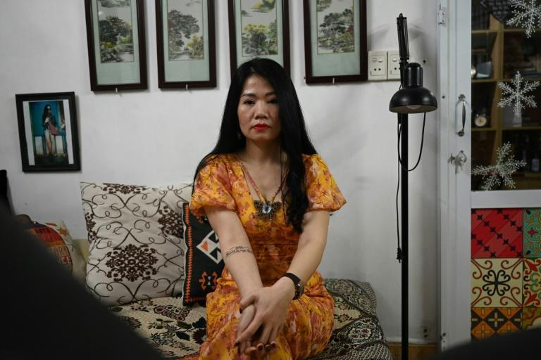 """Nguyen Hong Thai chose a rose tattoo over a scar on her stomach, and the words """"forever in my heart"""" on her arm, months after her husband died of lung cancer"""