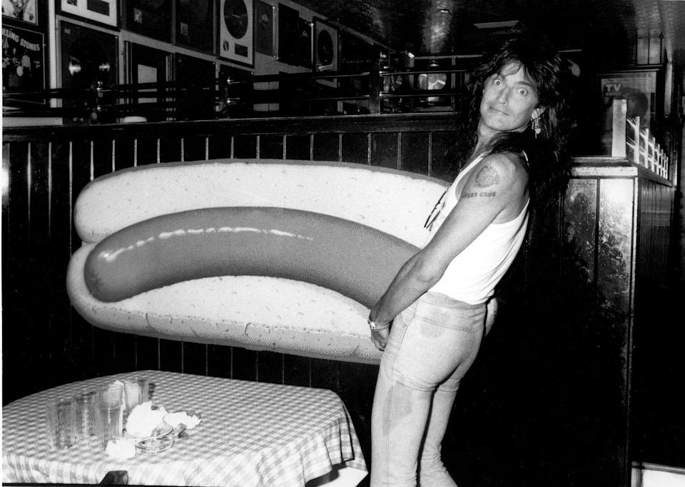 <p>Lee fooling around at the Hard Rock Cafe in New York City in 1985. During the band's performances, Lee was known for mooning the crowd at nearly every show.</p>