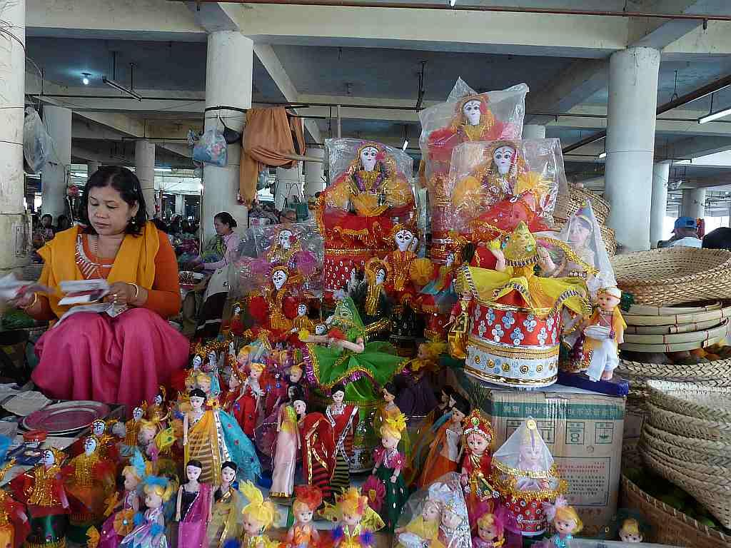 A woman sells dolls and trinkets at her stall in Ima Keithel, Imphal.