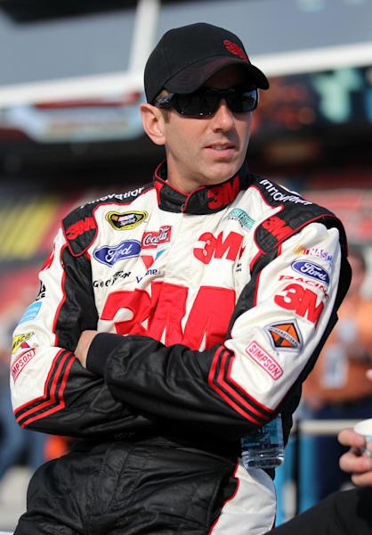 Driver Greg Biffle sits along pit road during qualifying for the NASCAR Sprint Cup series NRA 500 auto race at Texas Motor Speedway, Friday April 12, 2013, in Fort Worth, Texas. Biffle is looking forward to a do-over in the new Sprint Cup car. Texas Motor Speedway is an ideal spot since Biffle and the entire Roush Fenway Racing team have had so much success there. (AP Photo/Tim Sharp)