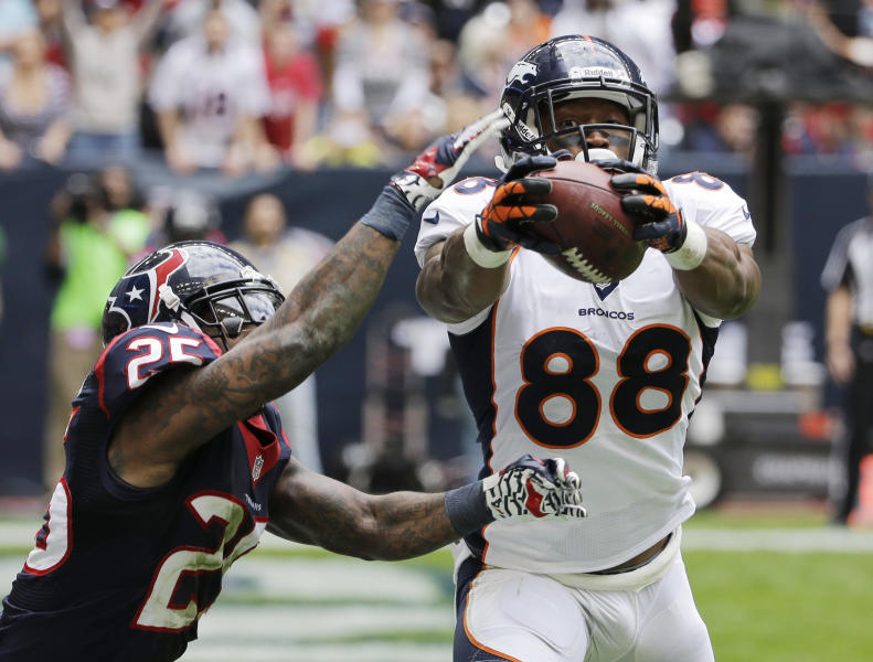 Houston Texans defender Kareem Jackson (25) breaks up a pass intended for Denver Broncos' Demaryius Thomas (88) during the second quarter of an NFL football game on Sunday, Dec. 22, 2013, in Houston. (AP Photo/David J. Phillip)