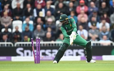 <span>Shoaib Malik of Pakistan hits the stumps with his bat</span> <span>Credit: GETTY IMAGES </span>