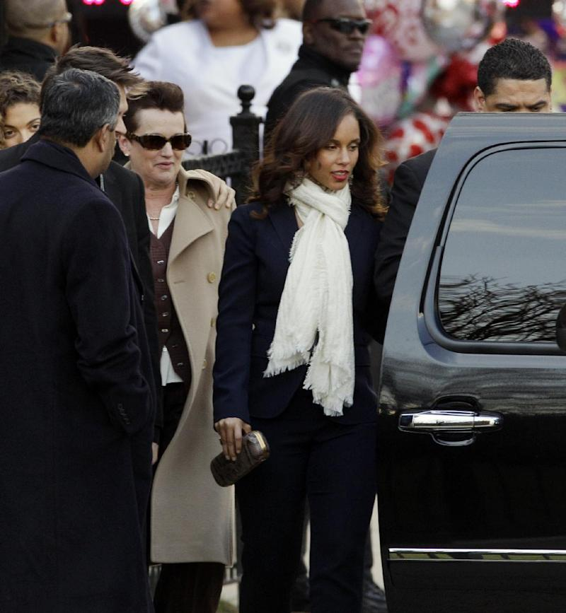 Singer Alicia Keys, center, leaves after a funeral service for Whitney Houston at New Hope Baptist Church in Newark, N.J., Saturday, Feb. 18, 2012. Houston died last Saturday at the Beverly Hills Hilton in Beverly Hills, Calif., at the age 48. (AP Photo/Mel Evans)
