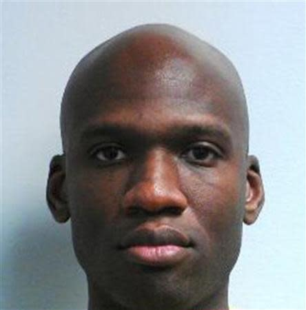 Aaron Alexis, who the FBI believe to be responsible for the shootings at the Washington Navy Yard in the Southeast area of Washington, DC, is shown in this handout photo released by the FBI on September 16, 2013. REUTERS/FBI/Handout via Reuters