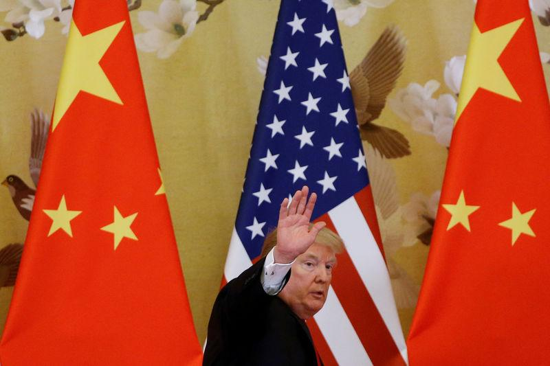 FILE PHOTO: U.S. President Donald Trump and China's President Xi Jinping make joint statements at the Great Hall of the People in Beijing