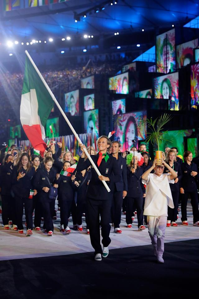 <p>In all-black outfits designed by Armani, the Italians looked like chic fashion ninjas, rather than athletes.</p><p><i>(Photo: Getty Images)</i><br /></p>