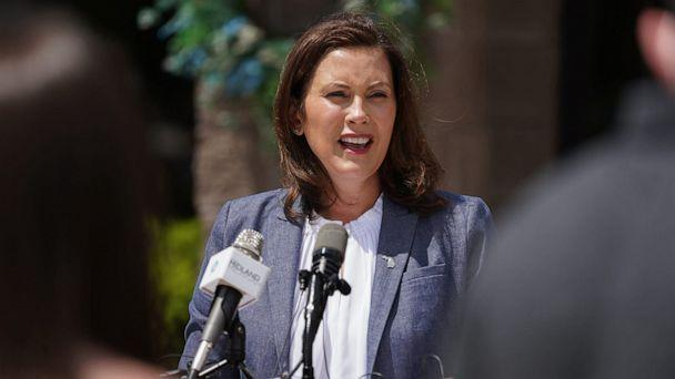 PHOTO: Michigan Gov. Gretchen Whitmer speaks to media outside of Meridian Elementary School in Sanford, Mich., May 27, 2020. (Ryan Garza/Detroit Free Press/TNS via Newscom, FILE)