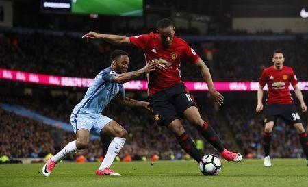 Britain Soccer Football - Manchester City v Manchester United - Premier League - Etihad Stadium - 27/4/17 Manchester United's Anthony Martial in action with Manchester City's Raheem Sterling Action Images via Reuters / Jason Cairnduff Livepic