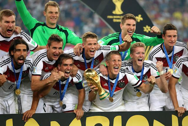 Germany's Bastian Schweinsteiger celebrates with the FIFA World Cup Trophy and team-mates after winning the FIFA World Cup Final at the Estadio do Maracana, Rio de Janerio, Brazil. (Getty Images)