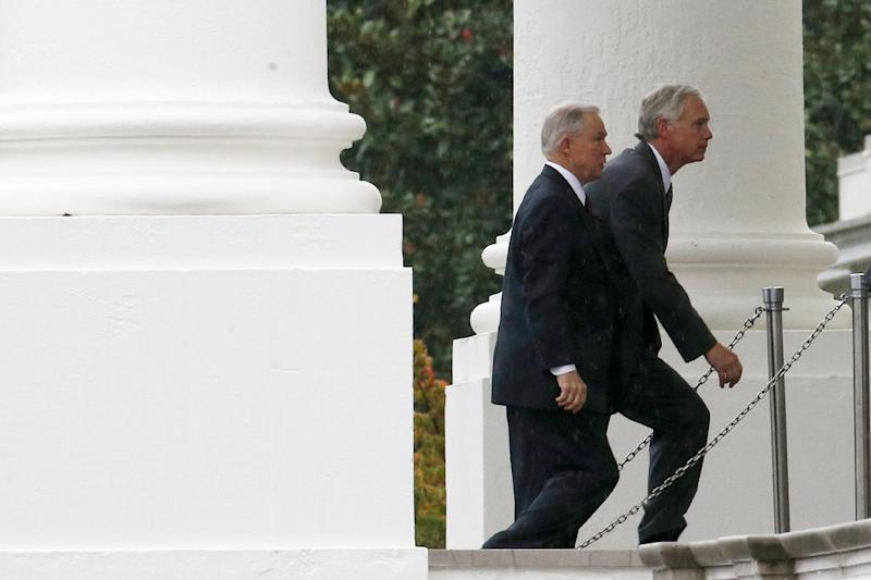 Sen. Ron Johnson, R-Wis., right, and Sen. Jeff Sessions, R-Ala., arrive with other Republican senators at the North Portico of the White House in Washington, Friday, Oct. 11, 2013, to meet with President Barack Obama regarding the government shutdown and debt ceiling. After weeks of ultimatums, President Barack Obama and congressional Republicans are exploring whether they can end a budget standoff that has triggered a partial government shutdown and edged Washington to the verge of a historic, economy-jarring federal default. (AP Photo/Charles Dharapak)