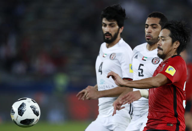 Japan's Urawa Reds Shinzo Koroki, right, challenges for the ball with Al Jazira's Musallem Faye, center, and Mohamed Eyed during the Club World Cup soccer match between Al Jazira Club and Urawa Reds at Zayed sport city in Abu Dhabi, United Arab Emirates, Saturday, Dec. 9, 2017. (AP Photo/Hassan Ammar)