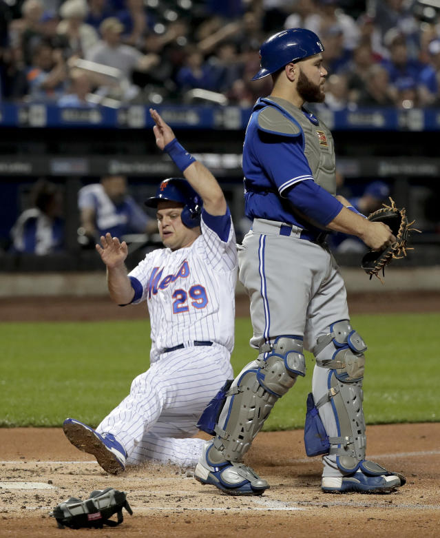 New York Mets' Devin Mesoraco (29) scores behind Toronto Blue Jays catcher Russell Martin on a double to right field by Noah Syndergaard during the second inning of a baseball game, Tuesday, May 15, 2018, in New York. (AP Photo/Julie Jacobson)