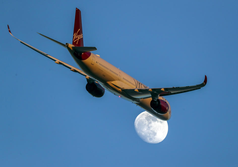 A Virgin Atlantic Airbus A350-1041 with registration G-VLUX passes the moon as it takes off from Heathrow Airport. PA Photo. Picture date: Thursday February 6, 2020. Photo credit should read: Steve Parsons/PA Wire (Photo by Steve Parsons/PA Images via Getty Images)